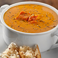 Roasted Red Pepper Soup with Yogurt Pesto Swirl